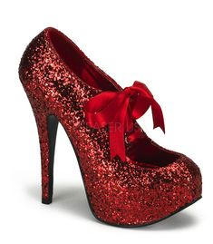"""Teeze pump in red glitter has a 1 3/4"""" concealed platform. With a 5 3/4"""" heel and a red ribbon tie at the top of shoe. Bordello Shoes offers a large selection of sleek to shiny patents, satin, sparkly"""