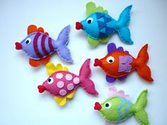 Meet the colourful 'Rainbow Kissing Fish' soon to be hung as a baby mobile. I am thinking of hanging from a felt covered ring with waves and...