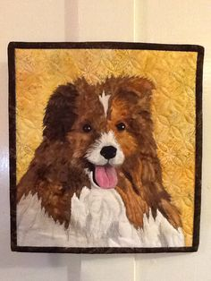 This is Sidney.  A little dog quilt I made with a mix of fusible appliqué and thread painting with a little pencil shading.