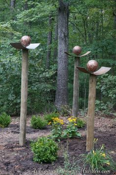 Penny Ball Garden Part 3: The balls are put on very cool posts.