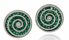 A PAIR OF EMERALD AND DIAMOND 'SPIRAL' EAR CLIPS, BY JAR Each modelled as a three-dimensional diamond-set spiral thread overlying a concave pavé-set emerald disc, mounted in platinum, gold and silver, 2002. Christie's.