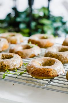 Sweet, fluffy Lemon Poppy Seed Healthy Baked Donuts drizzled with a melt-in-your-mouth glaze that are perfect for an indulgent (and guilt-free) breakfast, dessert or snack! (Gluten-free, dairy-free, refined sugar free, vegetarian)    #glutenfree #healthydonuts #bakeddonuts