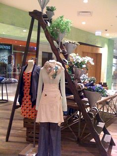 LOVE the pipe table base and wood top of table behind ladder  Anthropologie