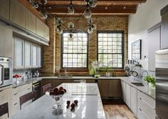 Vintage Industrial Kitchen in Chicago designed by Fred M Alsen of fma Interior Design walnutFlooring