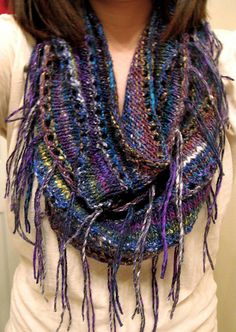I just picked up 3 skeins of Noro Silver Thaw yarn. I think I will make this with fingerless mittens to match.