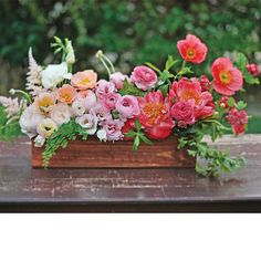 Brides.com: . Wedding centerpiece of garden roses, poppies, lisianthuses, ranunculuses, peonies, astilbes, hawthorns, maidenhair ferns, and mint arranged to create an ombré effect by Honey and Poppies, Long Beach, CA  Browse more pink wedding centerpieces.