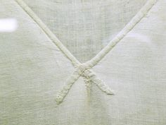 The neckline of the Saint Louis tunic. note the tiny dart at the point of the neckline; darts like this are also present at the points of the skirt gores.