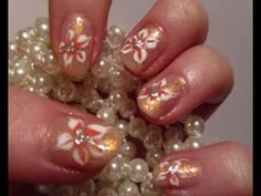 Beautiful peachy flower design with a shimmery peach backround and a basic flower. This desing is very versatile, you can use the flowers in many different designs. Use them for short or long nails. Use like I have used or paint them to your french tips if you have long nails :) First, choose your backround colour, I chose peach.  Then choose two...