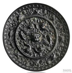 """An excellent """"Lion and Grapevine"""" mirror, China,Tang dynasty (618-907).Photo Nagel Auktionen"""