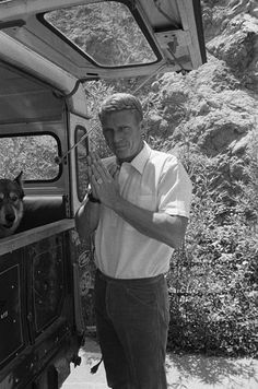 Steve McQueen at home on Solar Drive in the Hollywood Hills with his dog and Land Rover circa 1963