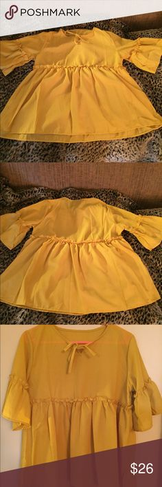 Marigold yellow babydoll top with flutter sleeves Mellow sunflower 🌻 yellow babydoll blouse. Keyhole tie at neck. Small ruffle below the chest and feminine flutter ruffle sleeves. This one is perfect for autumn, but will wear well all the way back to summer! Flawless condition! This is a One size fits all item. Will fit x small, small, medium and maybe large depending on desired fit. Ask about measurements if needed 🌻☺️ Tops Blouses