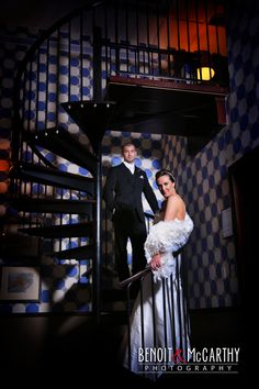 Bride and Groom climbing their own stair way to heaven! #Wedding photos at #Liberty Hotel