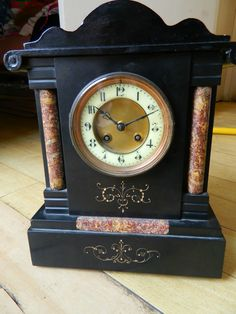 A Jappy Freres French slate/marble and wood striking mantle clock