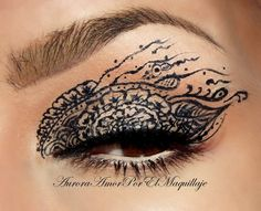 Henna Lace  WOW!  and NO!  Henna is not a tattoo... it is all natural pigment that is applied to the eye, hand, foot and when the 'clay' dries and flakes off, it leaves a natural stain that lasts for a while.