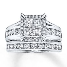 Four brilliant princess-cut diamonds are set in 14K white gold at the center of the engagement ring in this gorgeous bridal set for her. Round diamonds frame the center and are channel set into the bands of the engagement ring and matching wedding band. Milgrain detailing completes the look. The set has a total diamond weight of 2 carats. Diamond Total Carat Weight may range from 1.95 - 2.11 carats.