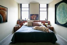 this bedroom's relatively narrow width causes no compromise to beauty or function.