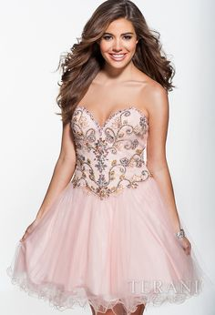 Sweetheart party dress featuring multi-colored crystals arranged in a paisley motif along the bodice. the basque waistline flows into a full, tiered mesh skirt