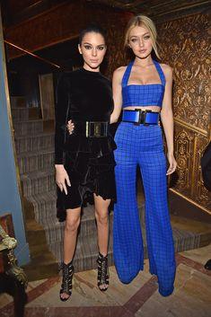 Kendall - Balmain Fall 2015 top, skirt and heels.. Gigi Hadid - Balmain Spring 2015 jumpsuit and belt.. #PFW
