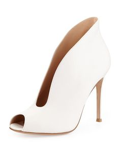 I usually don't do white shoes...but c'mon! These r it. Leather Split Peep-Toe Bootie, Cream by Gianvito Rossi at Neiman Marcus.