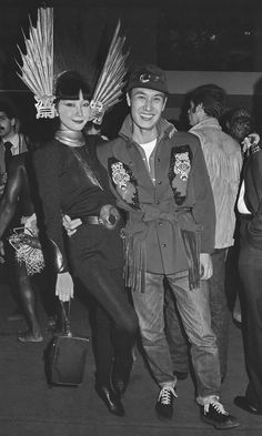 Designer Kansai Yamamoto and the model Sayoko pose at a party.