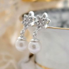 These Pearl Crystal Flower Earrings would look lovely on a bride or her bridesmaids.