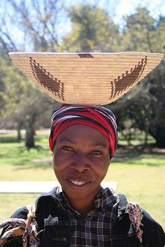 Ovambo Woman in Namibia, working with her carrying basket.
