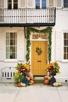 Lowcountry Charm - Pumpkin Ideas for Your Front Door - Southernliving. The Designer: Heather Barrie, Gathering Floral   Event Design, Charleston, South Carolina
