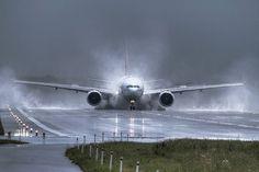 B777 lands at at the Warsaw Chopin Airport