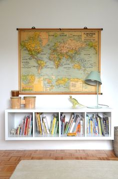 Wall map, books underneath.