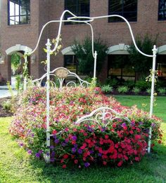 Let your garden overflow over an old bed frame!  Get some great plants at our Old Time Pottery Garden Centers!