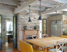 High ceilings with exposed beams, tall stone fireplace, and mixed tones hardwood floor. Description from pinterest.com. I searched for this on bing.com/images