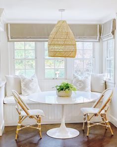 The clean simplicity of Scandinavian design meets the airy look of an open-weave pendant. Kitchen Banquette, Kitchen Benches, Dining Nook, Dining Table In Kitchen, Round Dining Table, Small Dining, Small Round Kitchen Table, Small Table And Chairs, Eat In Kitchen