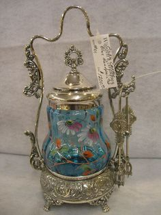 Wiggett's Antique Marketplace - Victorian Pickle Castor with a handpainted blue glass insert the frame is beautifully ornate Bottles And Jars, Glass Jars, Perfume Bottles, Victorian Decor, Victorian Era, Brides Basket, Condiment Sets, Pickle Jars, Antique Glassware
