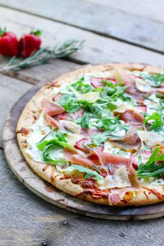 Prosciutto pizza with strawberries is savory and sweet all at once. It's covered in three kinds of cheese for pizza perfection!