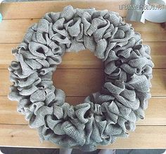 How to Make a Burlap Wreath - I am in love with this! One of my neighbors has one that I've been admiring for over a month...