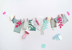 giochi di carta: Garland with scraps and cutouts