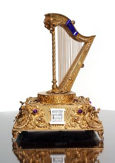 A late 19th century music box. After dining wealthy families would move to the  drawing room to finish the evening with some form of entertainment. Music was the most popular choice so every such household would have a piano or music box of some kind. The more ornate the music box was, the better - the most impressive were Jeroboam musical boxes which were equipped with trumpets, cymbals and moving clockwork figurines and could play ten different tunes.