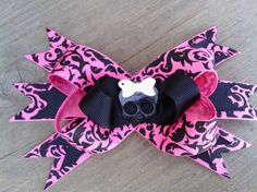 Damask hair bow..pink and black with skull. Etsy.com/shop/bowsnicecream