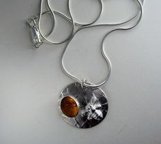 sterling silver textured pendant with amber stone and sand cast bee.