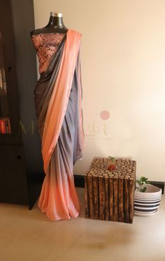 Beautiful combination of Peach and Grey in butter chiffon Saree given silver piping . Blouse - Heavy beadwork with chikankari and tube embroidery. For booking and inquiry,visit us at www.facebook.com/maneeti or whatsapp on 9539820656 #maneeti #maneetidesigners # chikankari #designersarees #chiffonsaree #butterchiffon #indiansaree #indianwoman #beadworks