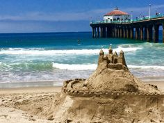 The popular Dwight Crum Pier-to-Pier Swim and Velzy-Stevens Paddle events, along with Junior Volleyball, rounded out the International Surf Festival activities. Beach Sand Castles, Manhattan Beach Pier, Paddle, Volleyball, Competition, Surfing, Swimming, Places, Beautiful
