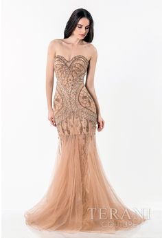 fitted   evening gown with sweetheart neckline and romantic crystal embellishments   covering the lace underlay from the bust until the fluted tulle skirt