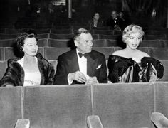A photo taken on October 14, 1956 shows (from L to R) actors Vivien Leigh, Sir Laurence Olivier and Marilyn Monroe.
