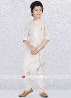 Graceful Beige color Linen cotton kurta with fancy buttons is to make you look very stylish. Comes with Matching bottom. Well crafted outfit is ready to make you more modish and fashionable. Kurta Pajama Men, Kurta Men, Kids Kurta, Kids Party Wear Dresses, Pathani Kurta, Boys Kurta Design, Kids Wear Boys, Mens Ethnic Wear, Mens Kurta Designs