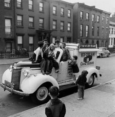 Children piled on an ice cream truck. Photograph by Ralph Morse. Brooklyn, New York, April 1949.