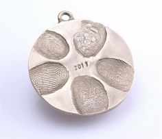 L-O-V-E this idea! Another must for Christmas Family Fingerprint Ornament (salt dough) 2 cups flour, 1 cup salt, cold water. Mix until has consistency of play dough. bake at 250 for 2 hours, then cool and spray with metallic paint. Family Fingerprint Ornament, Family Ornament, Fingerprint Necklace, Fingerprint Crafts, Thumbprint Necklace, Fingerprint Wedding, Thumbprint Pendant, Kids Ornament, Cool Ideas