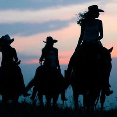 Cowgirls on horseback, silhouette.