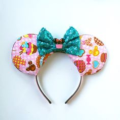 A personal favorite from my Etsy shop https://www.etsy.com/listing/242166326/mickey-treats-ears-cupcake-minnie-ears