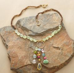 I like the cool, pebbled prehnite, the stacked smaller beads towards the ends, and the ring with the linked danglies.