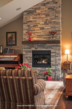 Definitely want to do a stacked stone around fireplace up to ceiling stone around fireplace! Not sure I love this color stacked stone. Home Fireplace, Fireplace Remodel, Brick Fireplace, Living Room With Fireplace, Fireplace Surrounds, Fireplace Design, Home Living Room, Fireplace Ideas, Gas Fireplace Inserts